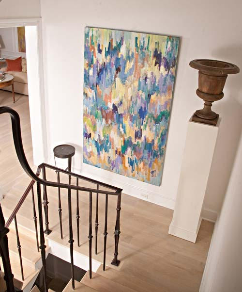 Robert Rea painting hung on stair landing